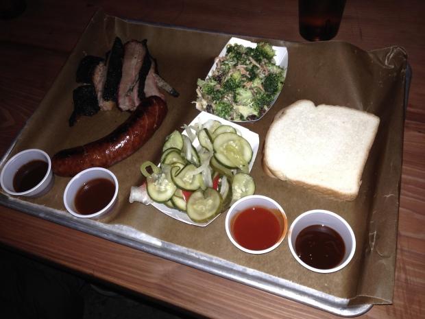 The spread - sliced brisket, hot link, spicy pickles, broccoli salad, and Wonder Bread